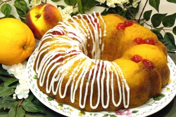 Fuzzy Navel Cake incorporates peaches, cherries, and peach schnapps into a fabulous dessert.