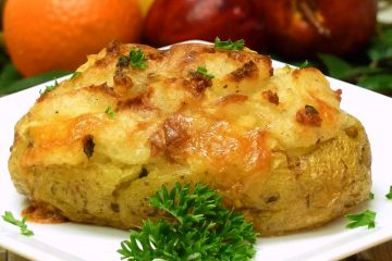 Brie Twice Baked Potatoes get kicked up a notch with brie cheese, bacon, and chives. So yummy!