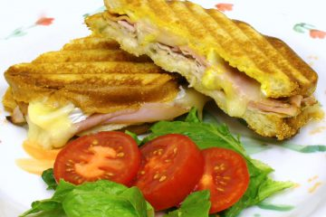 The Cuban sandwich goes gourmet with sun-dried tomato ham and brie cheese. Drool!