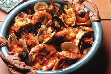 Cioppino is a fantastic San Francisco seafood stew loaded with yummy clams, crab, and shrimp. Yum!