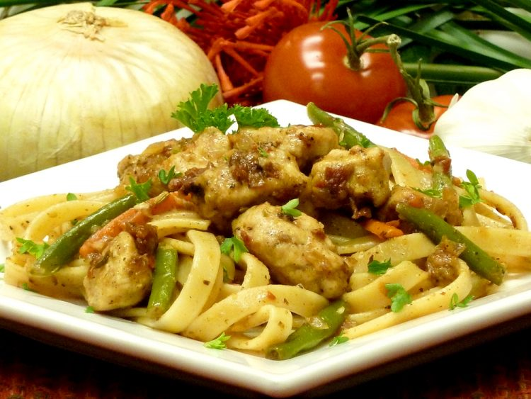 Chicken Sun-Dried Tomato Pasta with vegetables in a delicious wine sauce.