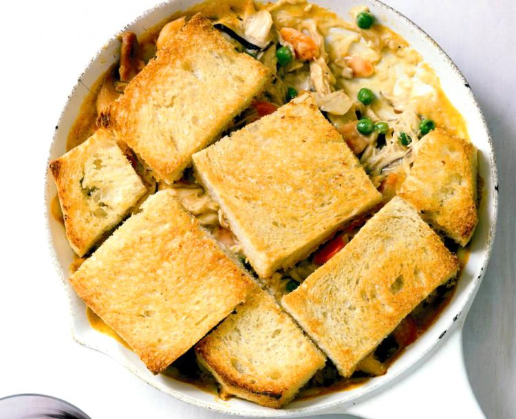 Skillet Chicken Mushroom Potpie is a yummy upscale version of the classic with shiitake mushrooms and crunchy bread topping.