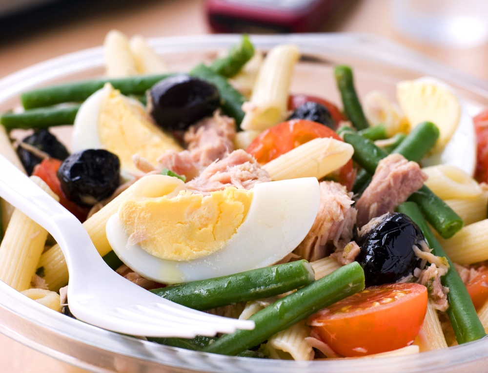 Colorful and tasty Pasta Nicoise Salad is loaded with chicken and vegetables.