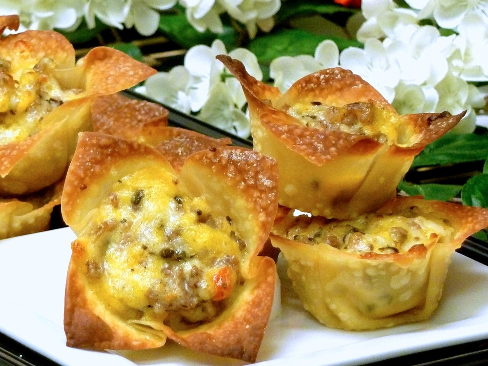 Cheesy Sausage Stars are crispy baked wonton cups filled with a delicious sausage cheese mix. Looks yummy, tastes yummier!
