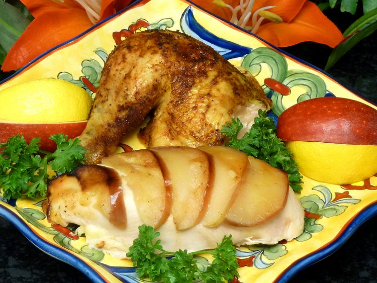 Lemon Apple Chicken is moist and tender due to apple slices tucked under the skin.