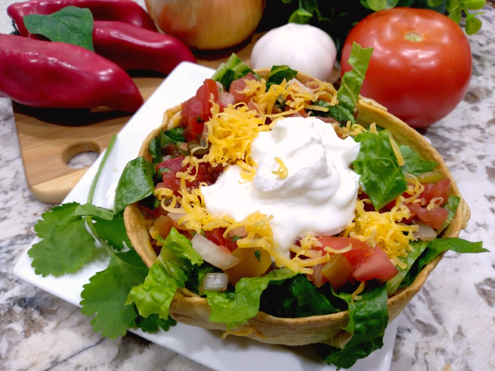 You can easily make a Taco Salad Shell Bowl at home in your air fryer.